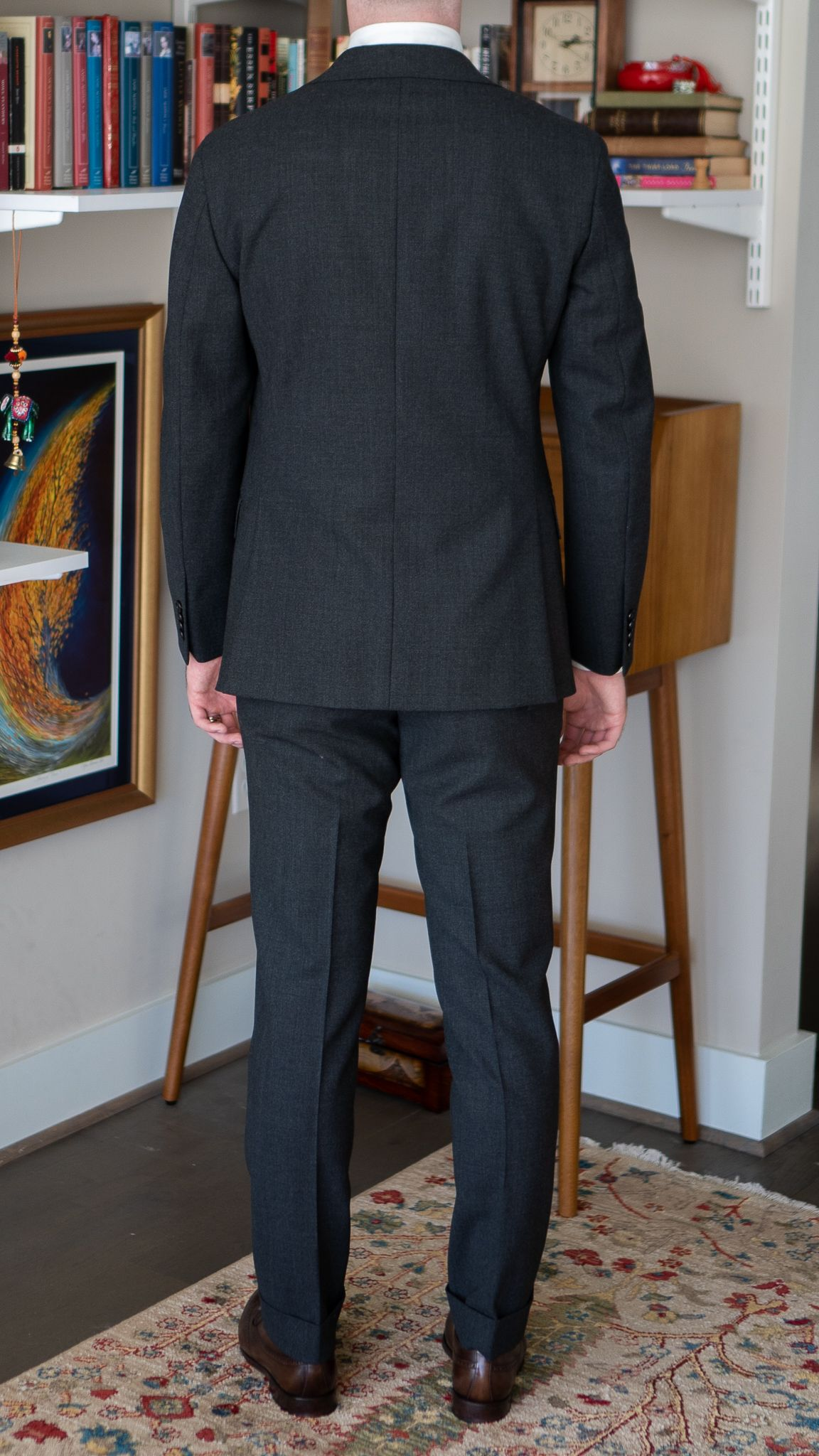 Full-length back view of A Rake in Progress wearing the Cavour gray winter hightwist suit