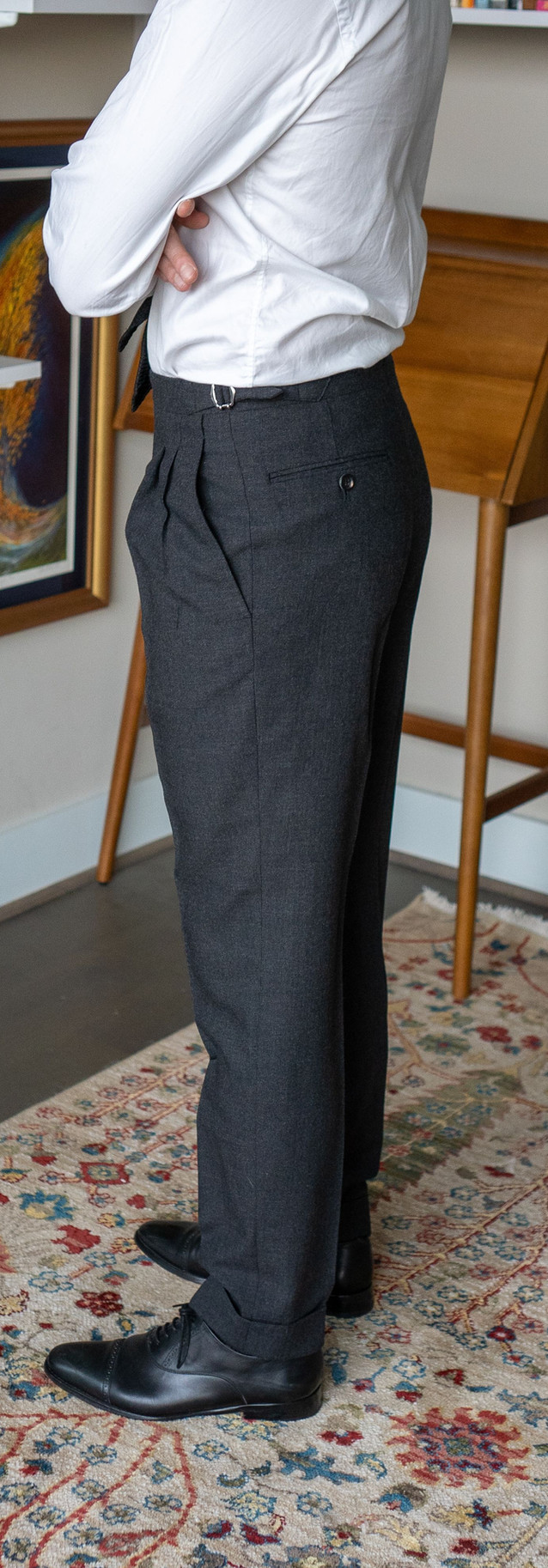 Full-length left side view of Anglo-Italian double-pleated trousers
