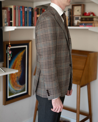 Right side view of A Rake in Progress wearing the Cavour beige check jacket and Anglo-Italian trousers