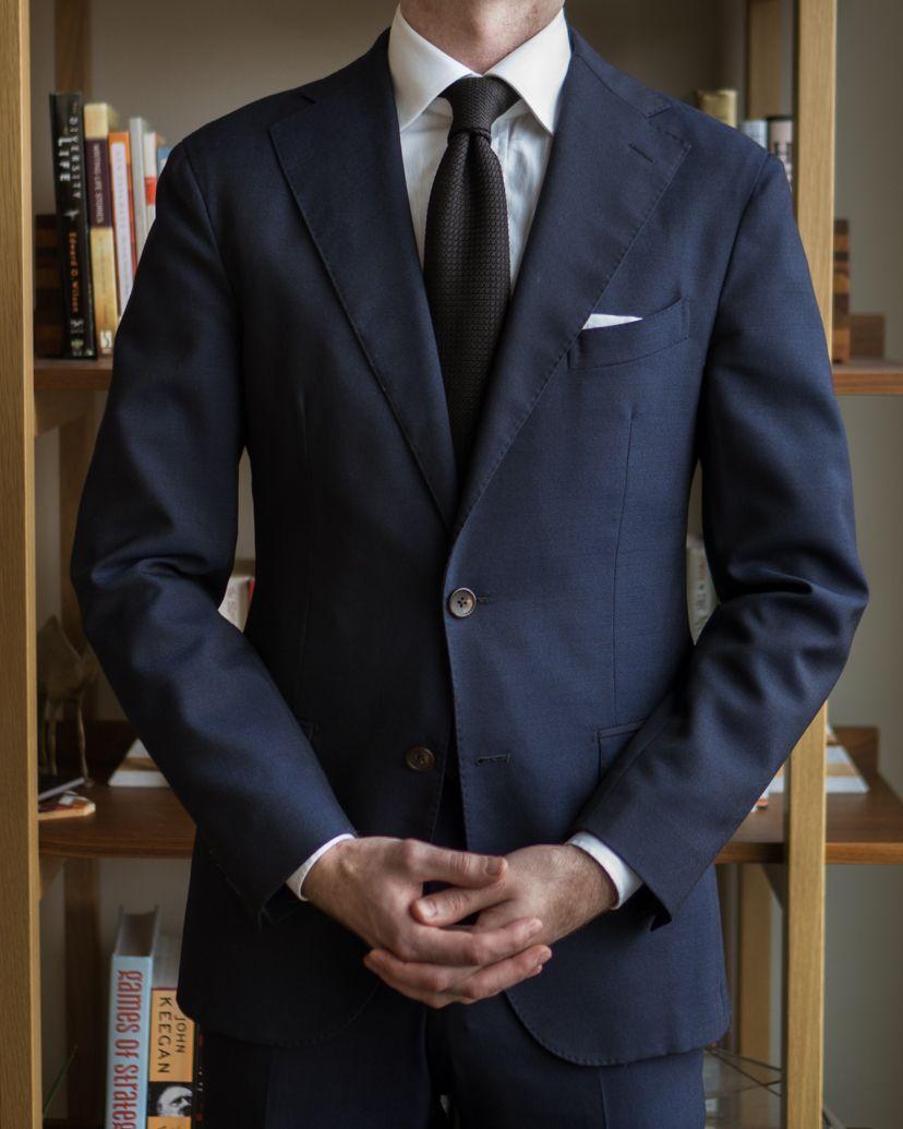 A Rake in Progress wears the Cavour navy hightwist suit and black Berg & Berg grenadine tie