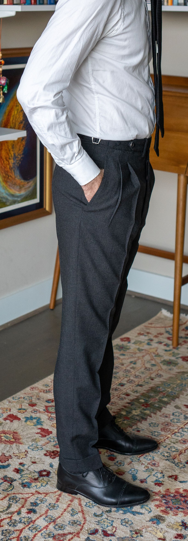 Full-length right side view of Anglo-Italian double-pleated trousers