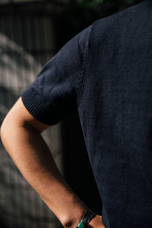 The sleeve attachment of the navy The Anthology knitted t-shirt