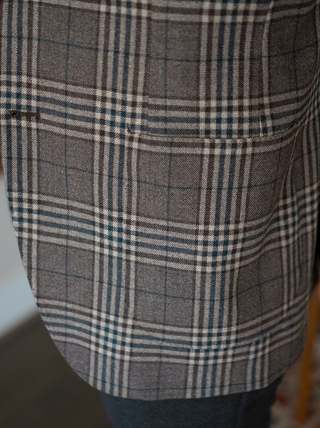 Close-up of pattern matching on patch pocket of Cavour beige check jacket