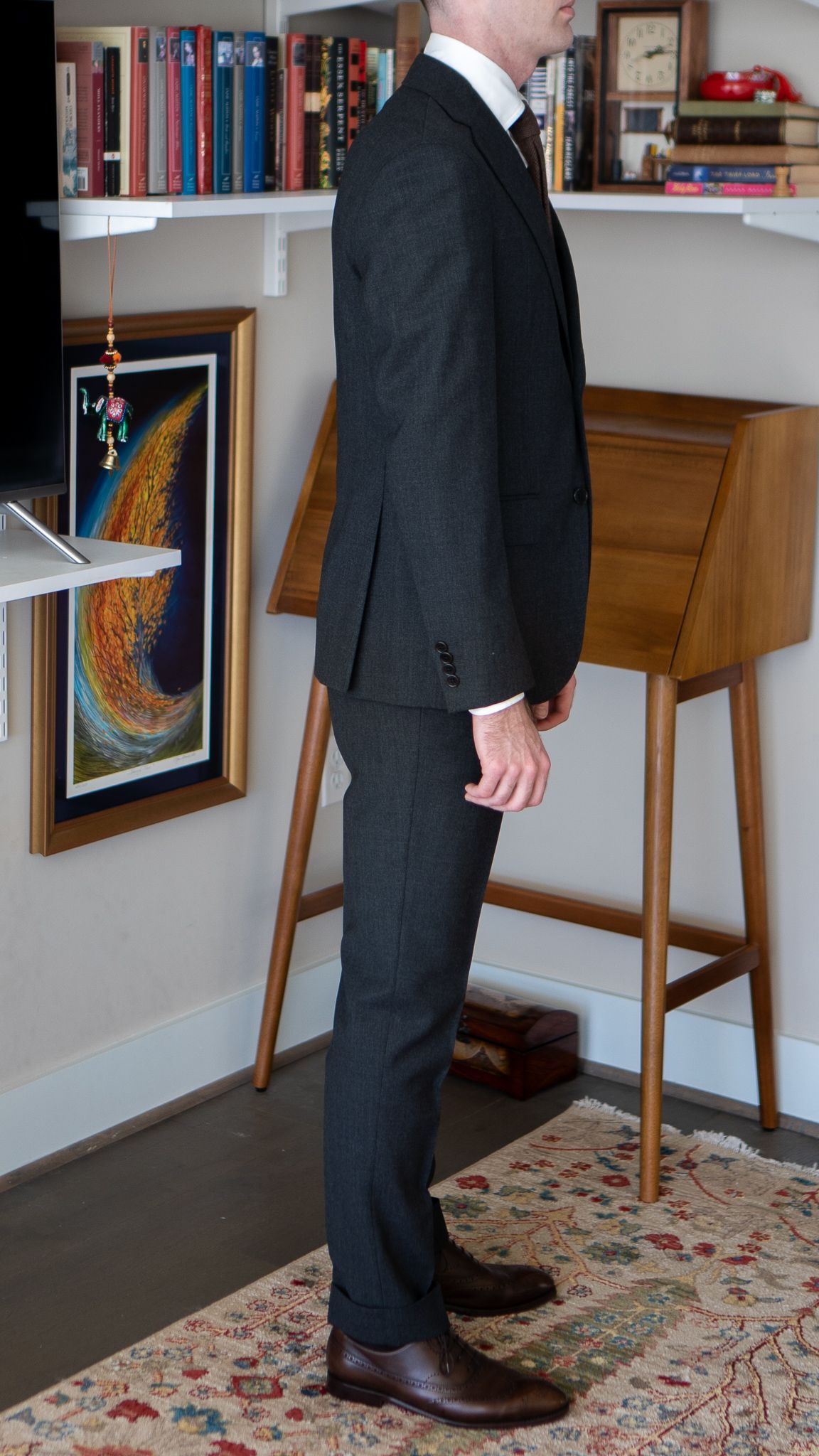 Full-length right side view of A Rake in Progress wearing the Cavour gray winter hightwist suit