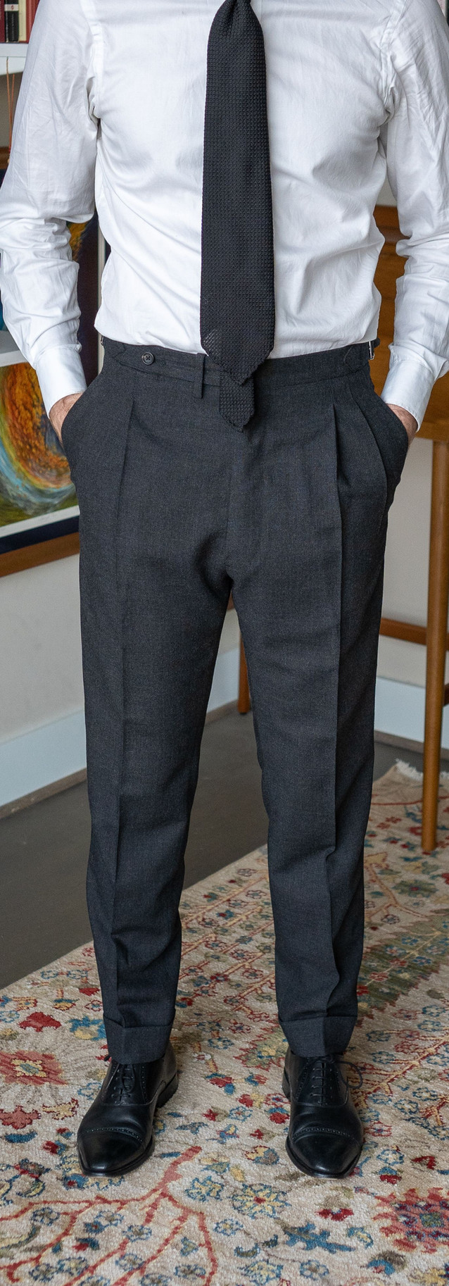 Full-length front view of Anglo-Italian double-pleated trousers