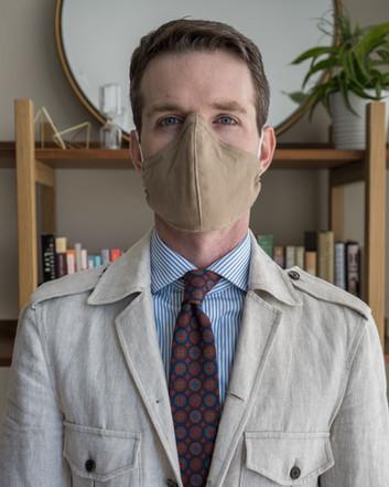 khaki Martin Greenfield mask worn with Spier MacKay dress shirt H. N. White London Irish poplin tie, and Lopez Aragon Masai safari jacket