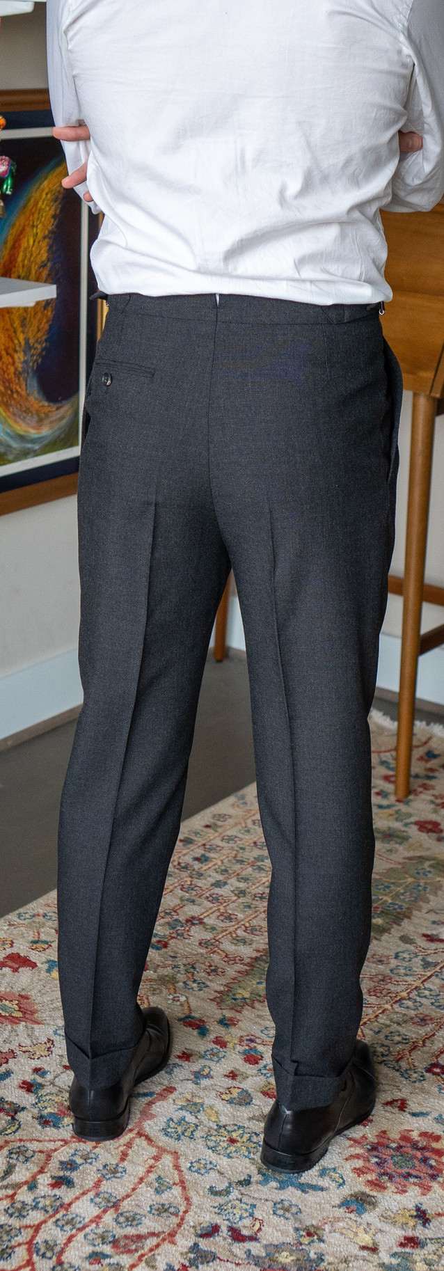 Full-length rear view of Anglo-Italian double-pleated trousers