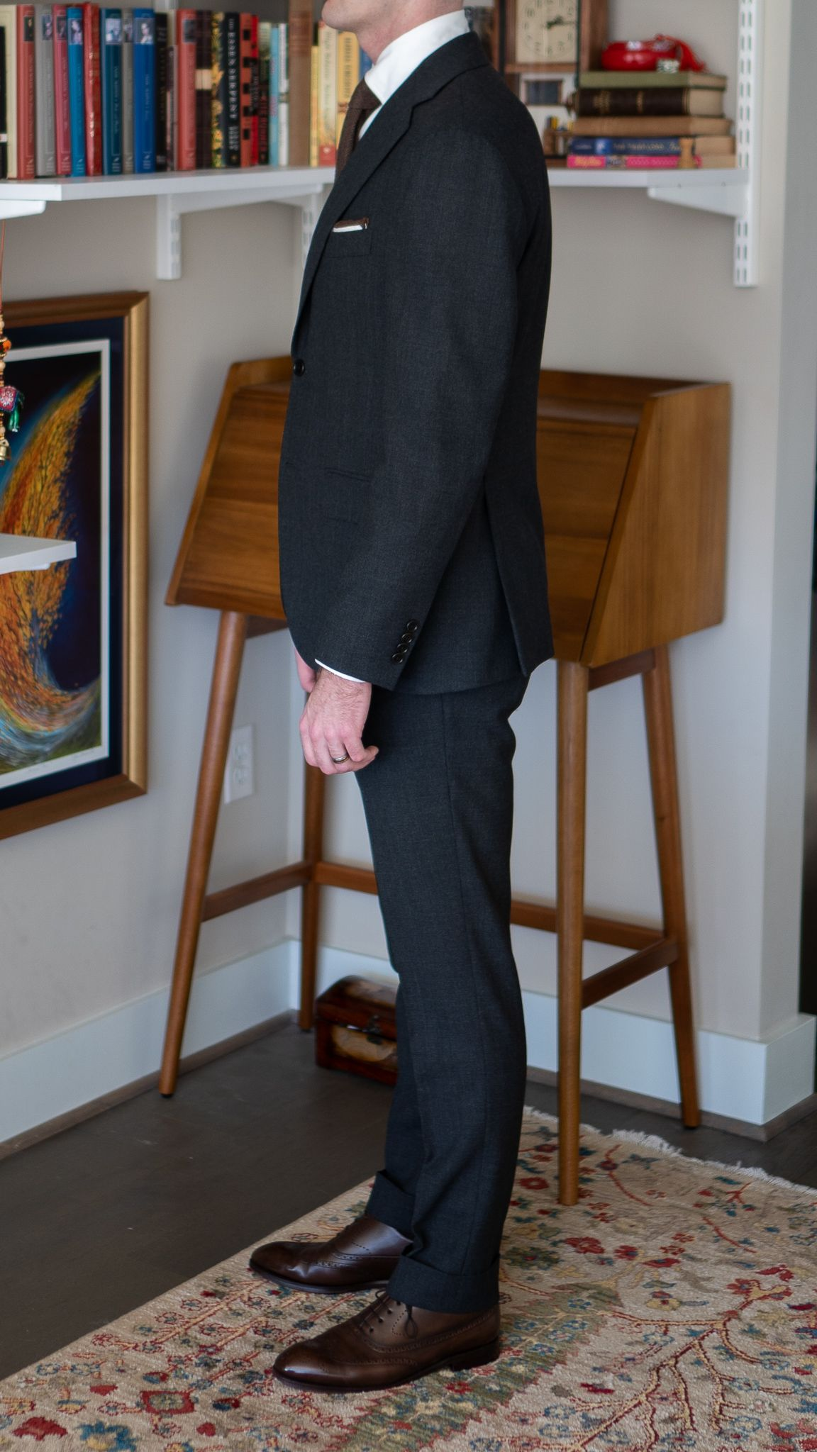 Full-length left side view of A Rake in Progress wearing the Cavour gray winter hightwist suit