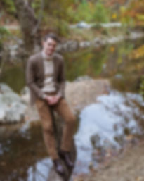 Picture of A Rake in Progress Author, David, wearing a Colhay's turtleneck and Spier & MacKay gun check sports coat in Rock Creek Park
