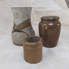 mixed stoneware and earthenware vessels