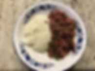 Tin%20beef%20and%20grits_edited.jpg