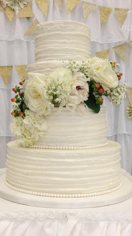 Round Wedding Cake with Textured ButercreamRuffle and Floral Spray