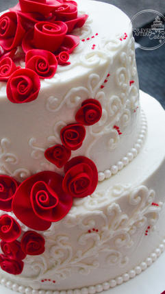 Wedding Cake with Red Rolled Roses and Hand Piped Lace