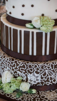 Brown and Ivory Wedding Cake with Stripes, Dots and Hand Piped Lace
