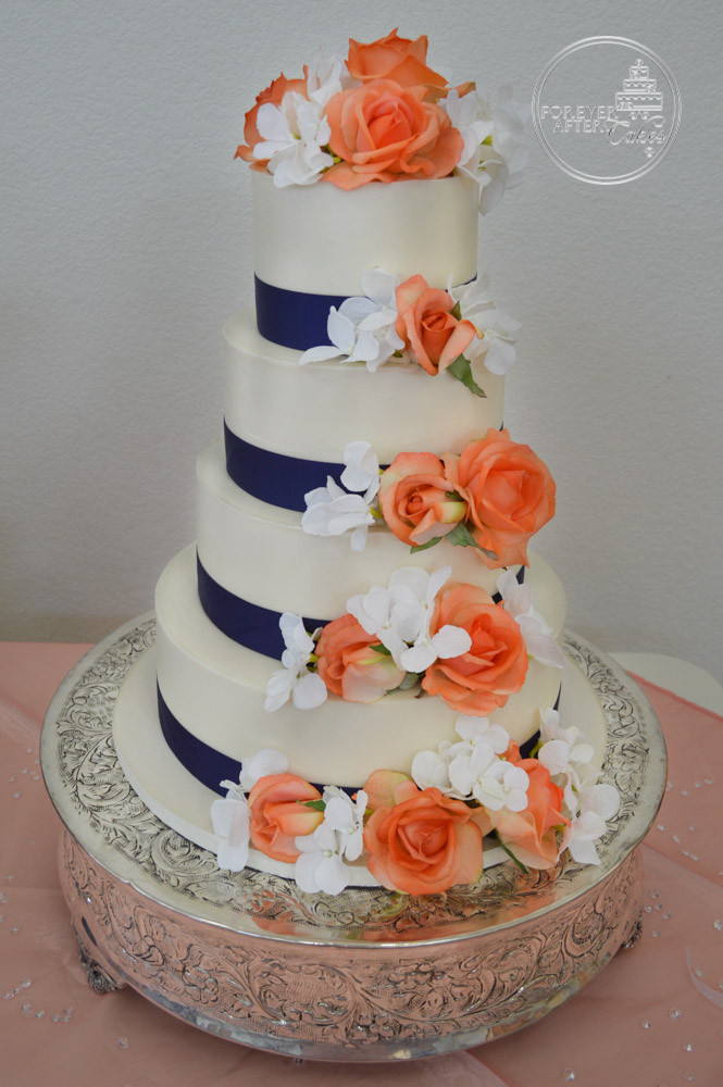 Round Wedding Cake With Blue Ribbon And Orange Flowers