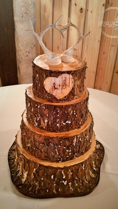 Tree Trunk Wedding Cake with Bark Carved Heart and Deer Horns Topper