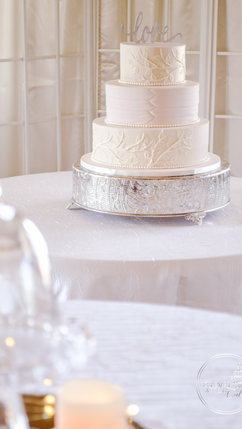 Round Wedding Cake with Branches and Fon