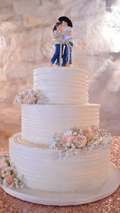 Rustic Elegant Cowboy Wedding Cake with Flowers and Buttercream Ruffle