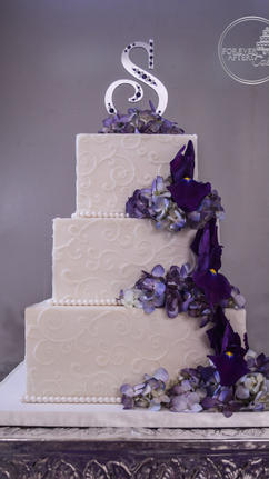 Square Wedding Cake with White Scrollwork and Purple Iris Cascade
