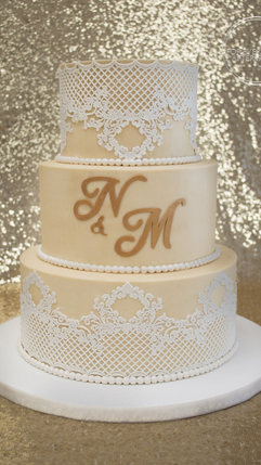 Lace wedding cake with gold monogram and