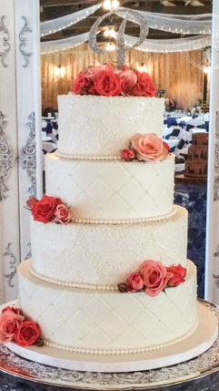Lace Applique Wedding Cake with Coral Flowers