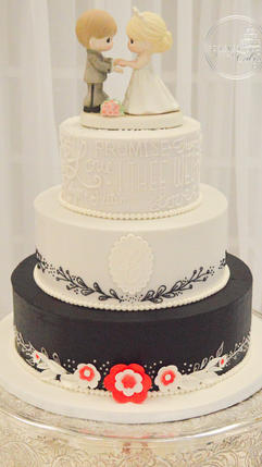 Round Black and Red Wedding Cake with Wo