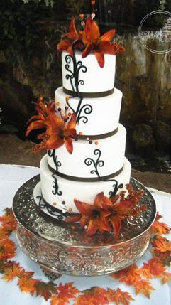 Round Fondant and Butterceam Wedding Cake with Orange Lillies Brown Scrollwork