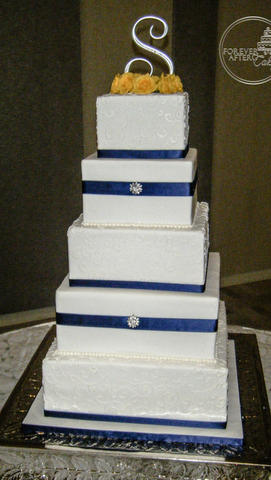 Square Wedding Cake with Navy Ribbon and  Brooch
