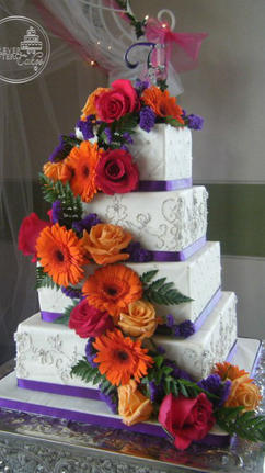 Square Wedding Cake with Silver Embroidery Purple, Ribbon and Floral Cascade