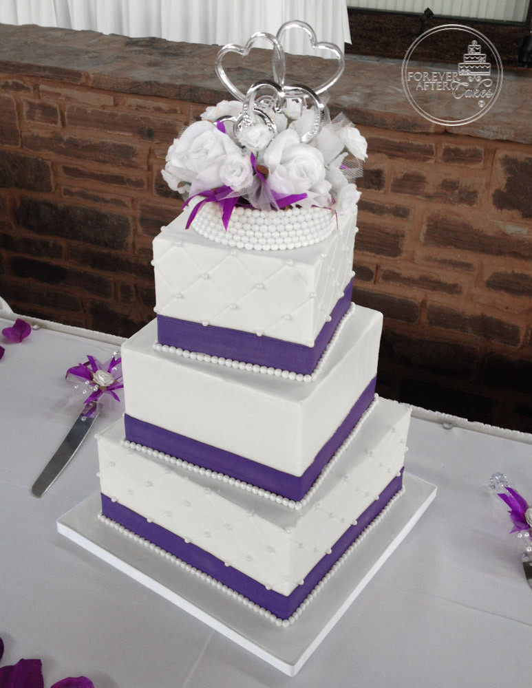 Square Wedding Cake With Quilting Pearls And Purple Fondant Ribbon