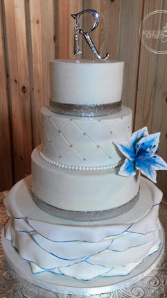 Wedding Cake with Blue Lilly Fondant Ruffle and and Silver Accents