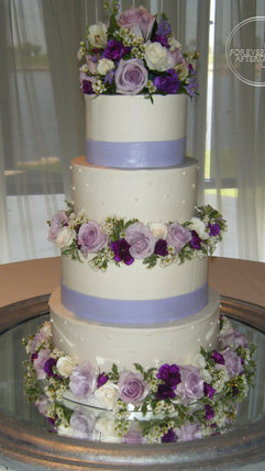Purple and White Wedding Cake with Fondant Ribbon and a Flower Separator