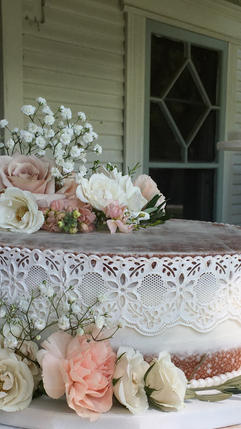 Un-stacked Shabby Chic Naked Wedding Cake with Edible Cake Lace and Fresh Flowers