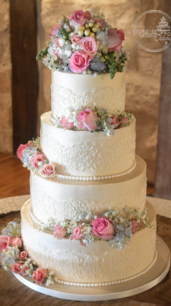 Wedding Cake with Buttercream Lace Stencil and Scattered Fresh Flowers