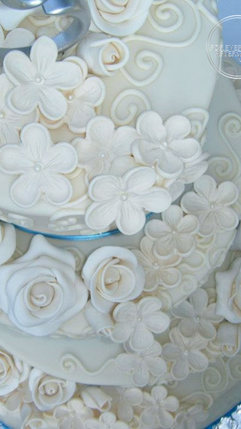 Round Fondant Wedding Cake with Gumpaste Daisies, Roses and Piped Swirls