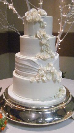 Round Butercream Wedding Cake with Rolled Roses and Shirred Fondant