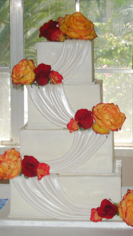 Square Wedding Cake with Draped Swags and Orange & Red Roses