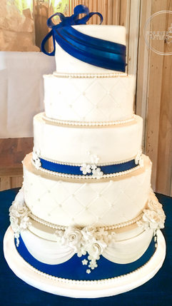 Navy and White Wedding Cake with Fondant Bow, Flowers and Swags