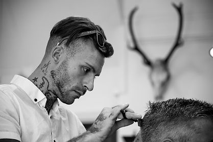 Bobby Brown cutting hair at Bexhill Barber shop