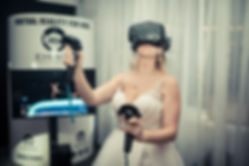 Bride playing virtual reality at her wedding