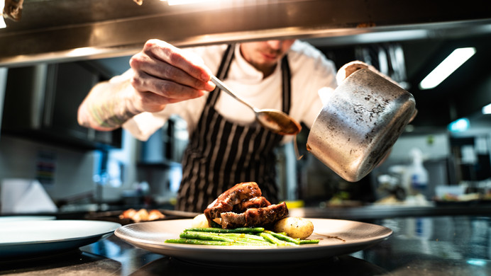 Chef Making A Rump Lamb