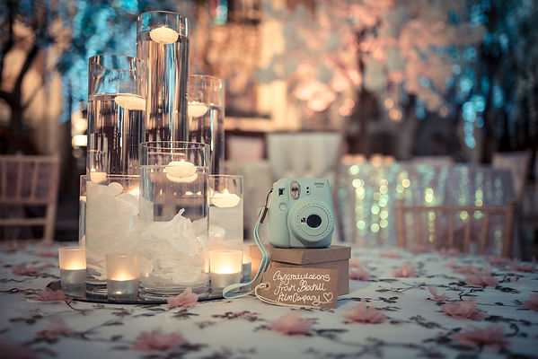 Polaroid hire on a table set by Sam Chapman of Mulberry Events