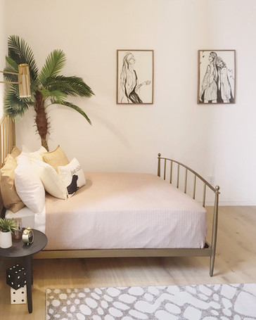 Two large drawings in a bedroom