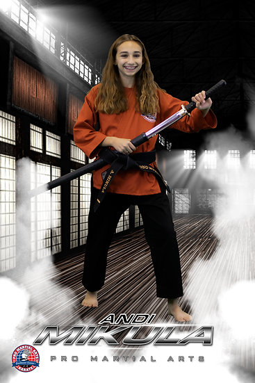 Andi with weapon in dojo