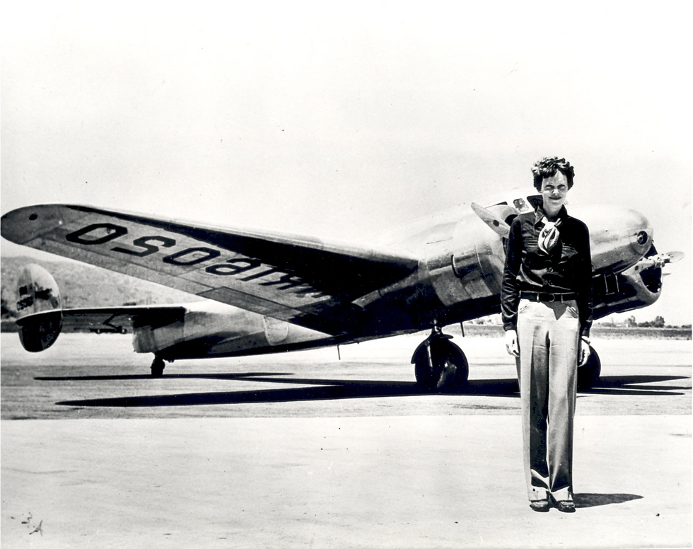 Amelia with Plane.png