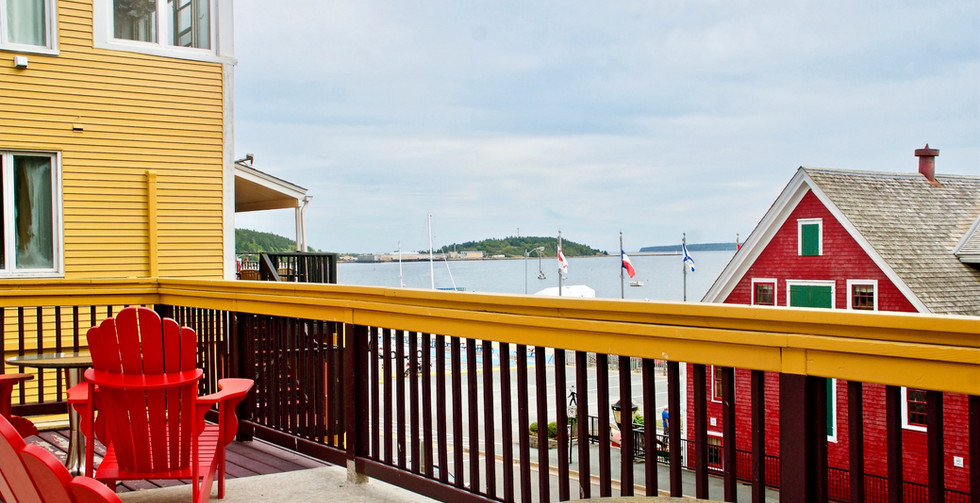 Enjoy an evening glass of wine while sitting out on the semi - private veranda looking out over the water.