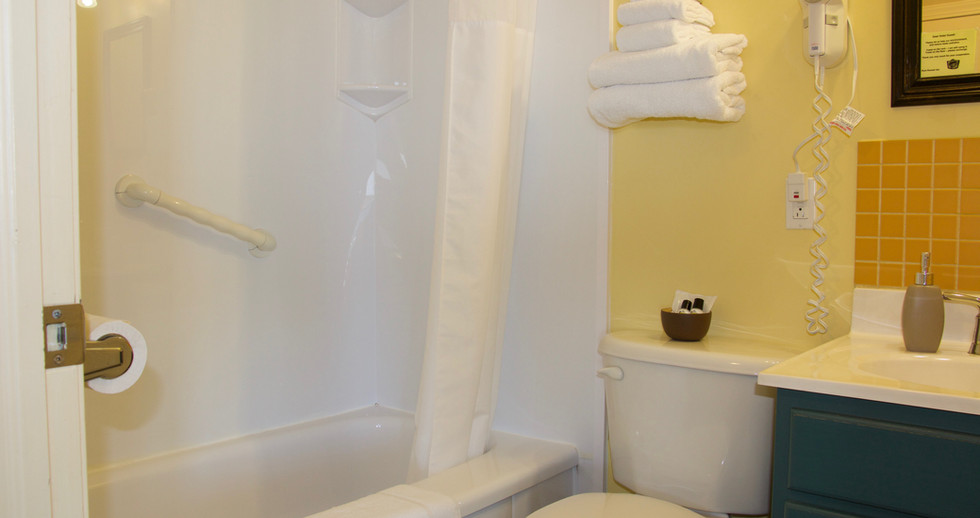 In-room bathroom with a bathtub, perfect for that relaxing bubble bath you never have time to enjoy.
