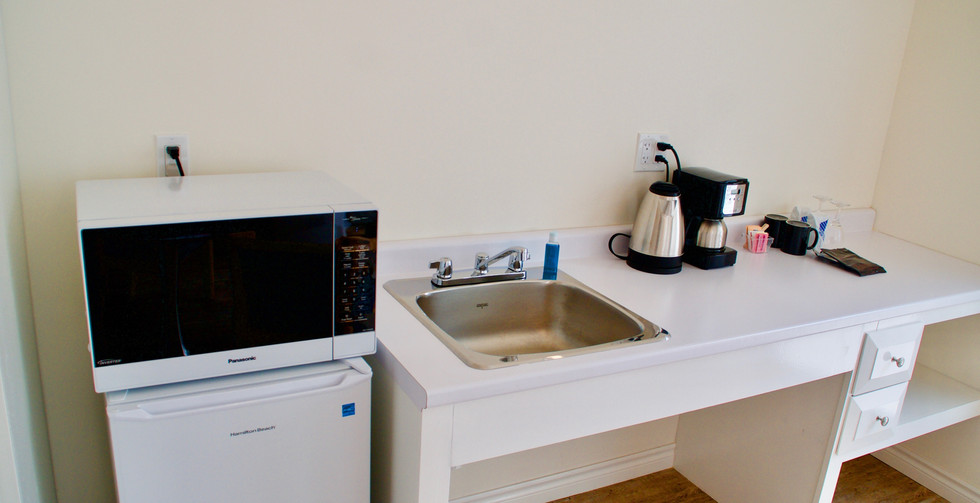 These spacious rooms also boast an in-room kitchenette, complete with microwave, mini fridge, and sink.