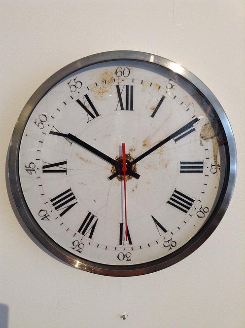 Broken faces wall clock