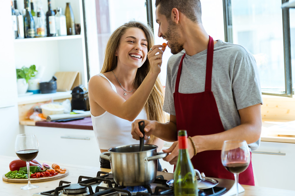 young couple together in kitchen